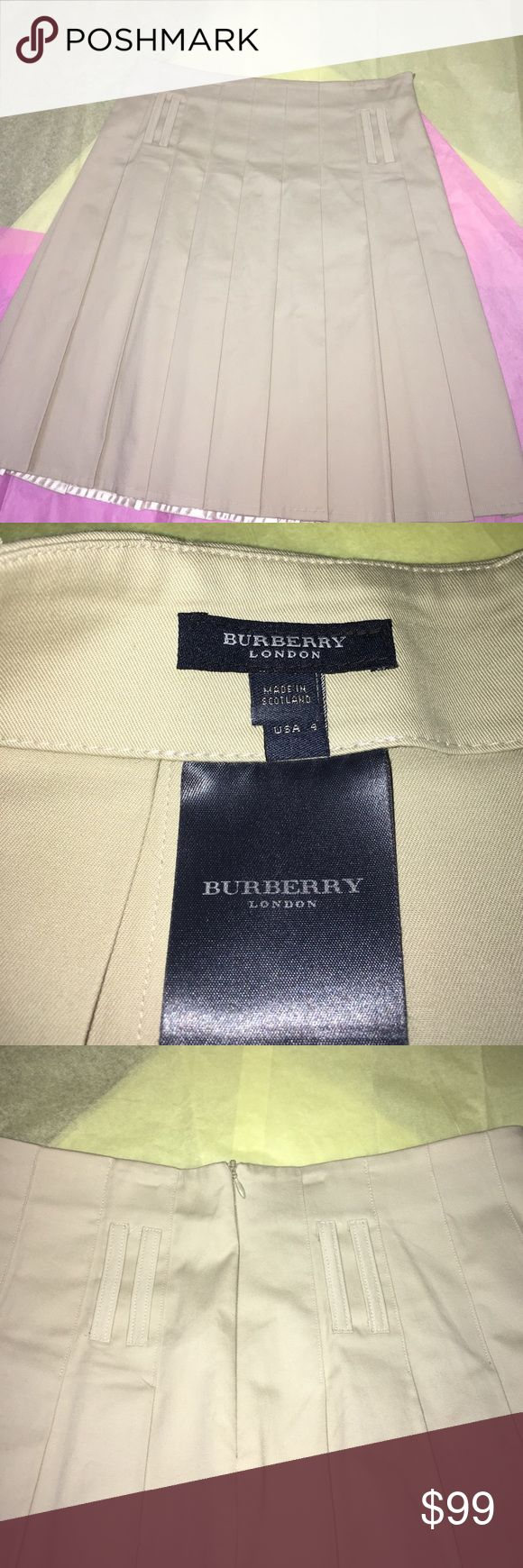 "Authentic Khaki Burberry Skirt. ❤️🌺 Classic and Timeless. 22"" long and waist measures 31"". Zip up in back and has 4 classic double belt loops.  Like New Condition! Here at addition to your closet. Reasonable offers accepted👍🌸 Burberry Skirts Midi"