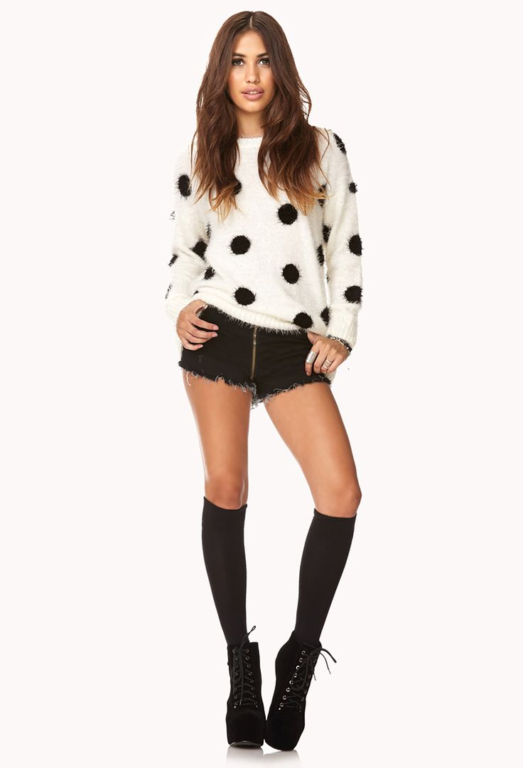 Pola dot sweater paired with highwaisted black jean shorts