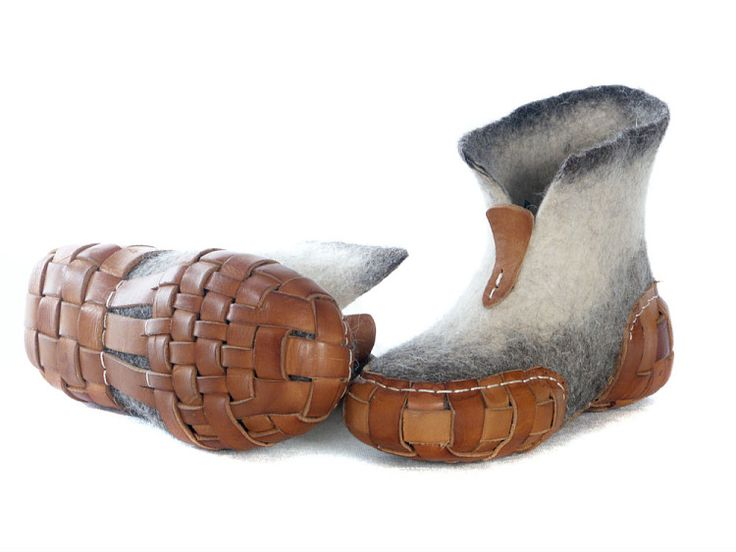 Felt boots with woven leather soles.