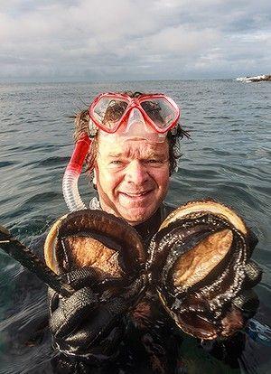 Tour operator Rob Pennicott harvests abalone.