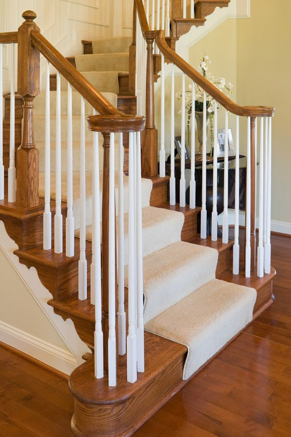 Elegant Oak Staircase With Carpet Runner And Wide Treads