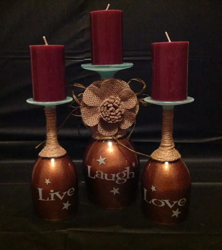 Wine glass candle holder I sandblasted the Live Laugh Love and the stars used patina Rub N Buff and inside the glasses I used that stone paint and a sealer used jute up the stem added a burlap flower and candles