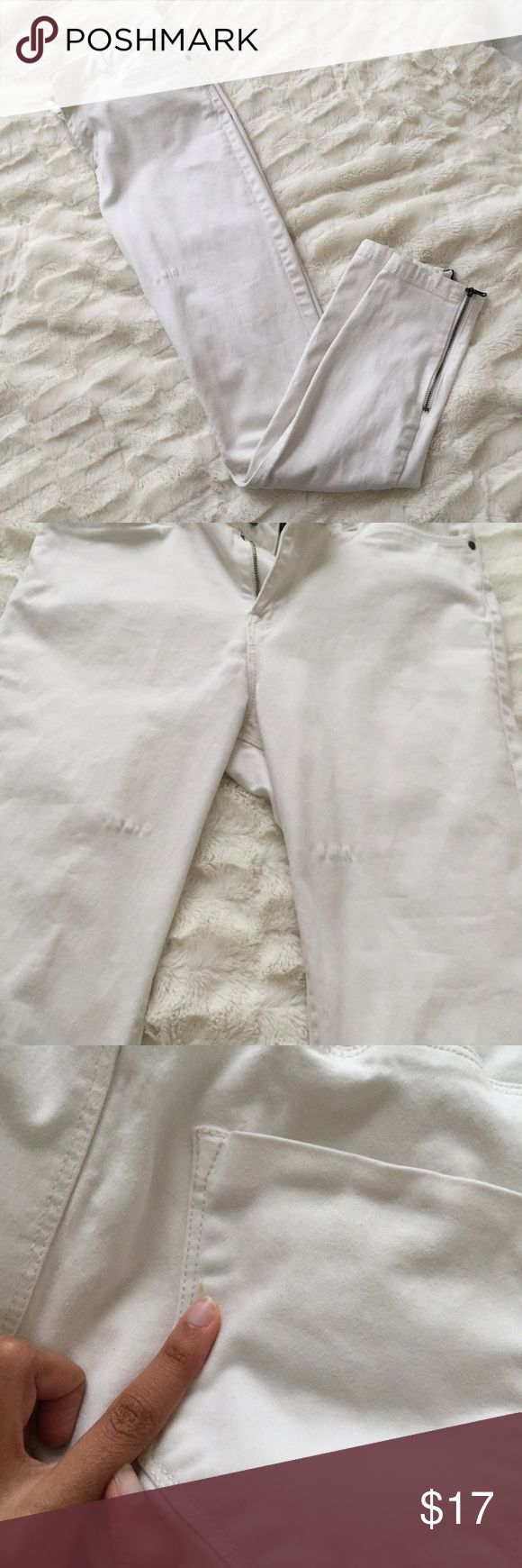White skinny jeans Worn dozens of times. Features cute zips on the ankles. Some wear as shown as well as a small stain on the back of the jeans. Tag says 27, but will best fit a 26! DO NOT ASK TO TRADE OR YOU WILL BE BLOCKED. Forever 21 Jeans Skinny