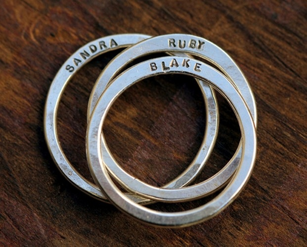 Name rings. Silver. Names are on the side, which is interesting. Sandra, Ruby, Blake. #namejewelry