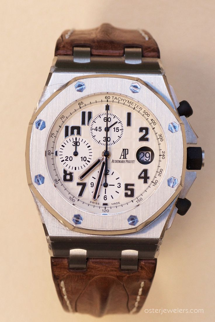 """Shown in stainless steel with brown """"hornback"""" strap and Safari beige dial. It has a stainless steel case, sapphire crystal, black rubber-clad screw-locked crown and pushpieces, and is water resistant"""