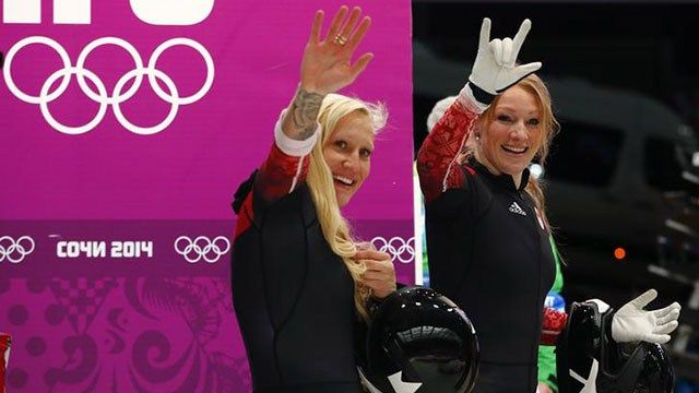 Canada's Kaillie Humphries and Heather Moyse have won gold in the women's bobsled event Wednesday at the Sanki Sliding Center in Sochi.