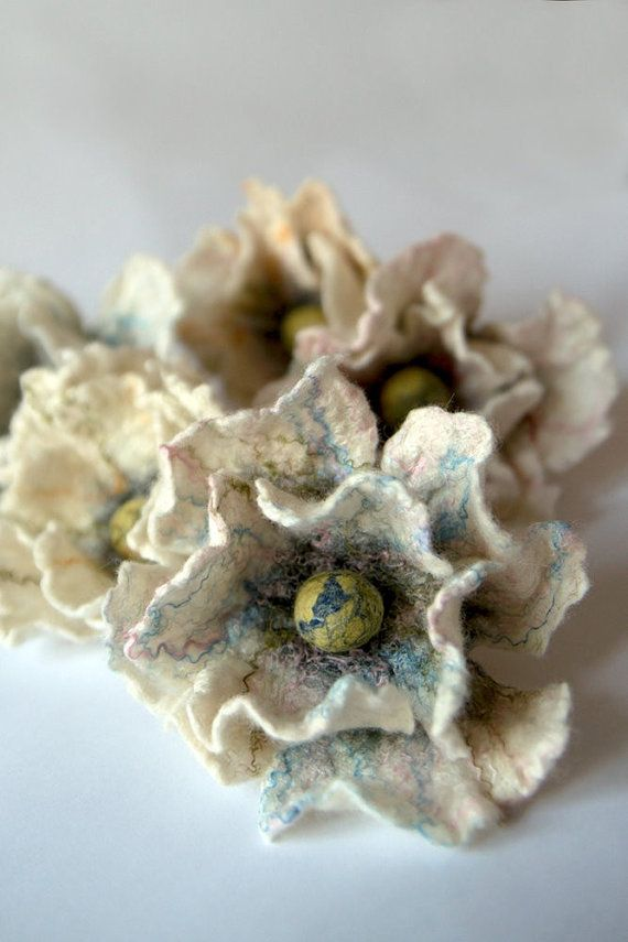 Beautiful felted flowers! I love how the blues are slightly mixed with the beige flower petals--It gives the overall flower a delicate look.