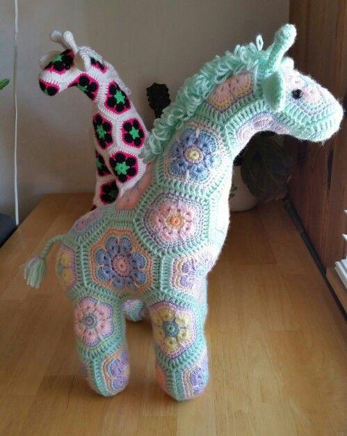 Giraffe pattern by Heidi Bears using African flower motifs. Love!