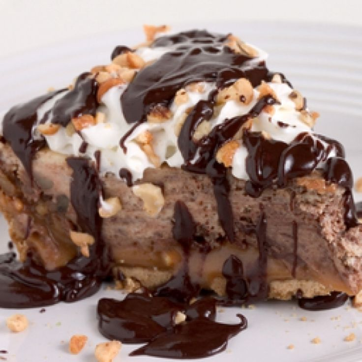 thick and creamy caramel chocolate mousse pie on top of a flaky pie ...
