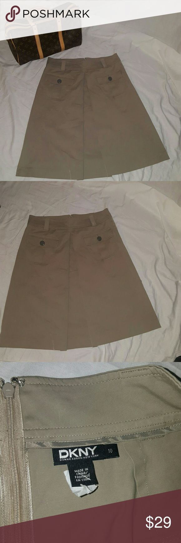 DKNY pleated Khaki skirt size 10 Adorable DKNY skirt great condition size 10. Looks cute with a plain t shirt or dress up Skirts A-Line or Full