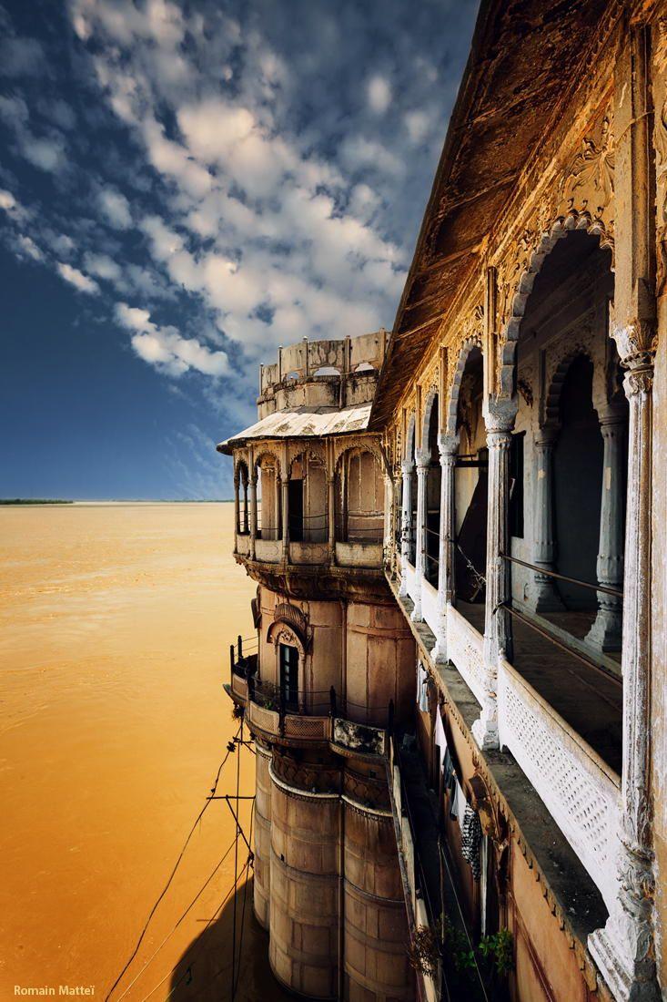 ramnagar fort + ganges river in flood, varanasi, india