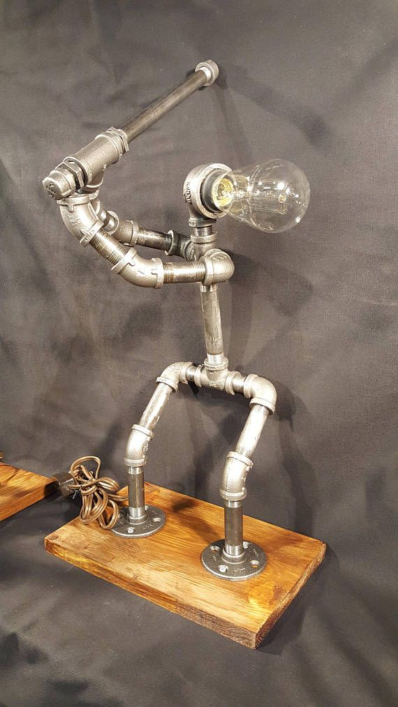 Handmade lighted sculpture that is made from black industrial plumbing pipe. This can act as room lighting while showing your love of the national past time. Pair this lighted sculpture with the Baseball Catcher lamp sculpture to create the perfect conversation piece for any home. This