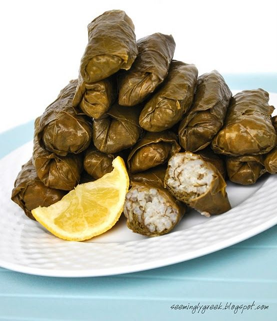 Dolmades – Stuffed Grape Leaves (NOTE:  This link goes to 20 awesome Greek recipes! YESSSSSSS!!)
