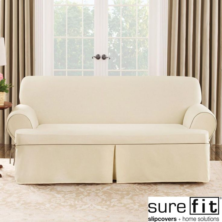 Protect your comfy couch with this natural-colored sofa slipcover.This cover features a contrast cord duck pattern and a classic design that blends in with your living room. Made from a cotton/polyester blend, this cover is also machine washable.