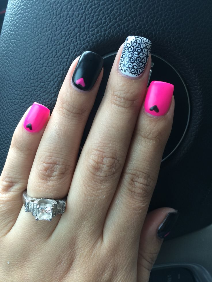 Pink and black nails with hearts and scroll stamp. Nails by holly