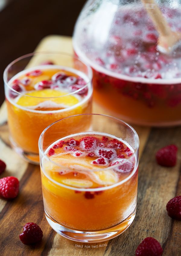 Raspberry Peach Prosecco Punch - Frozen Raspberries, Peach Nectar, Prosecco.