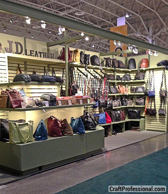 Lots of handmade purses display on slatboards