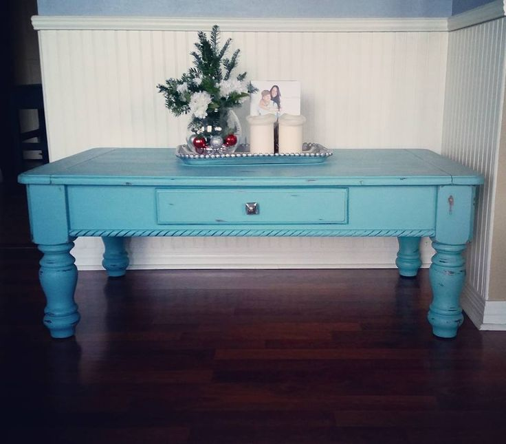 hand painted and distressed coffee table painted with agave colored chalk paint and sealed with