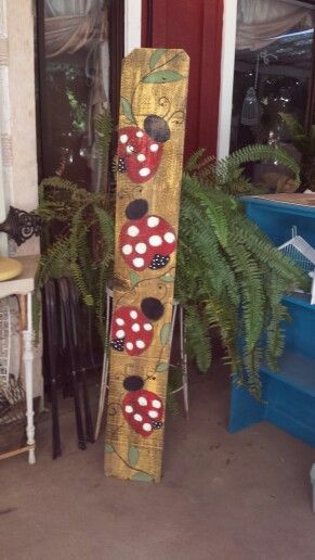 I painted these friendly lady bugs on an old fence board.  We be next to my flower garden