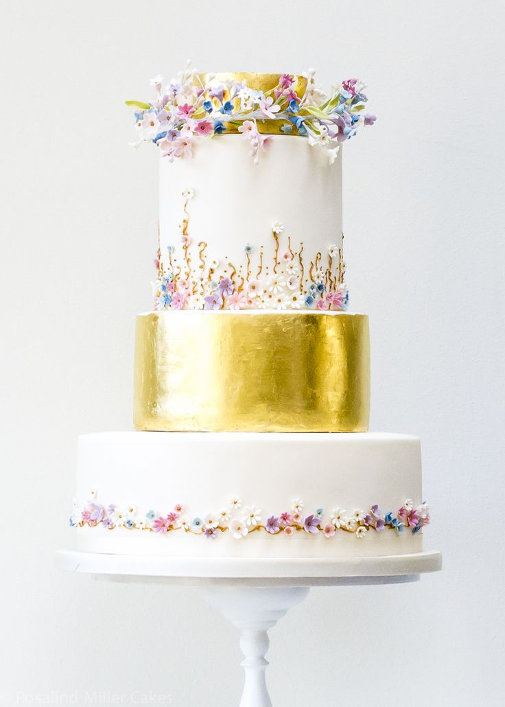 The flowers and gold in this wedding cake are so special!