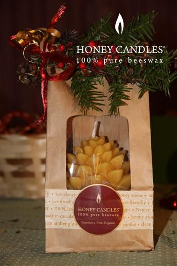 Who on your Christmas Gift List Will Love Beeswax Candles? Honey Candles® beeswax Pine Cone candle packaged in repurposed packaging for the environmentalist!