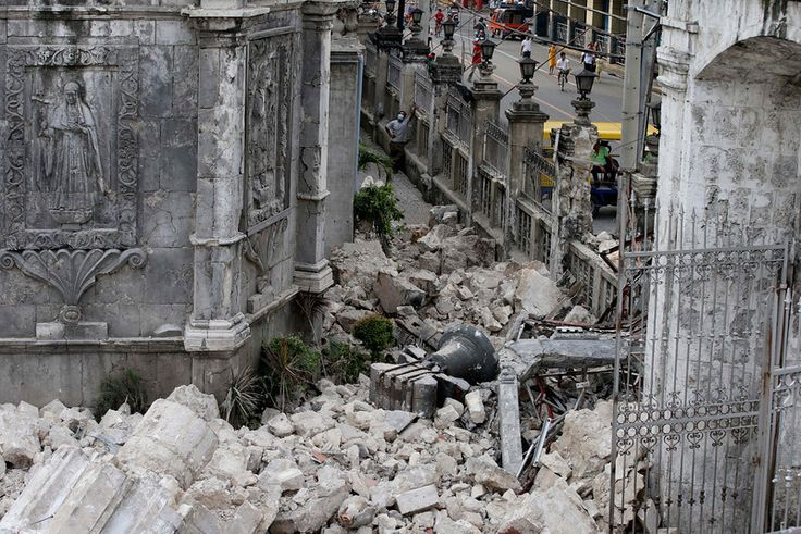 The bell of Basilica of the Holy Child lies amidst the rubble following a 7.2-magnitude earthquake that hit Cebu city in central Philippines...