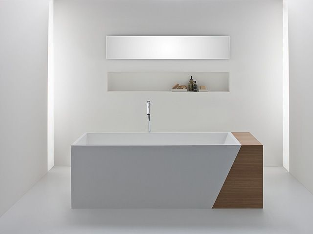 I like the wooden accent within the all-white space. The Latis bath with timber storage end by Omvivo.