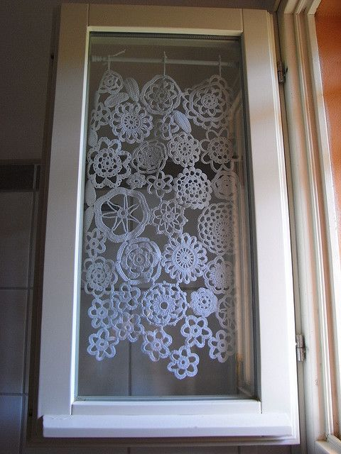 sweet little crocheted doily curtains; I bet these would make some awesome shadows in the morning when the sun shines through the bedroom windows!