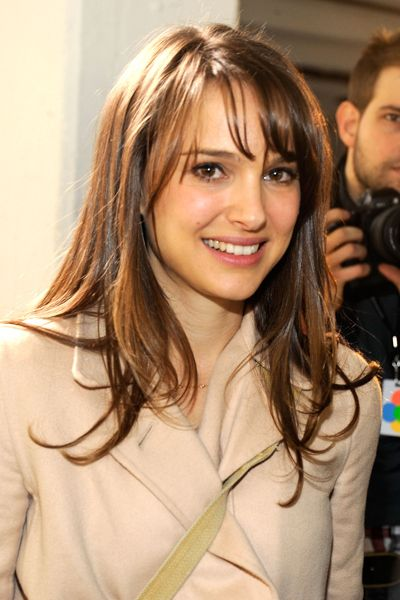 Wispy, side-swept bangs like Natalie Portman's are a great complement to a round face. Get a flattering haircolor to match here: http://www.haircolorforwomen.com/breakthrough-hair-color-system-your-salon-doesnt-want-you-to-know-about-p/