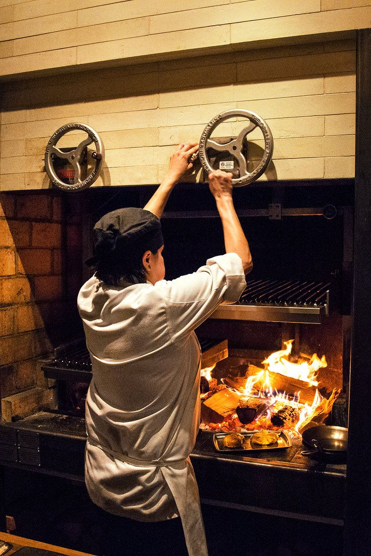 Lilia's wood-burning grill runs as hot as a forge. (Photo: Devin Yalkin for The New York Times)