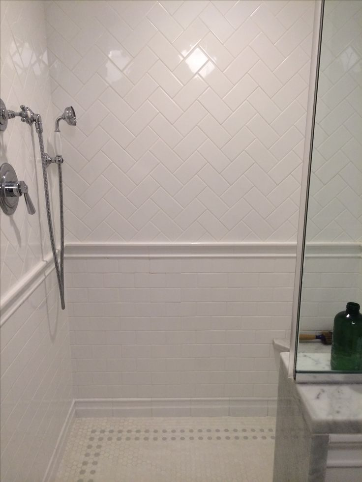 Like the 2 tile patterns in the shower  One on top and one on bottom  with divider in the middle  May also want to add tile behind vanity. 1000  ideas about White Tile Shower on Pinterest   Large tile