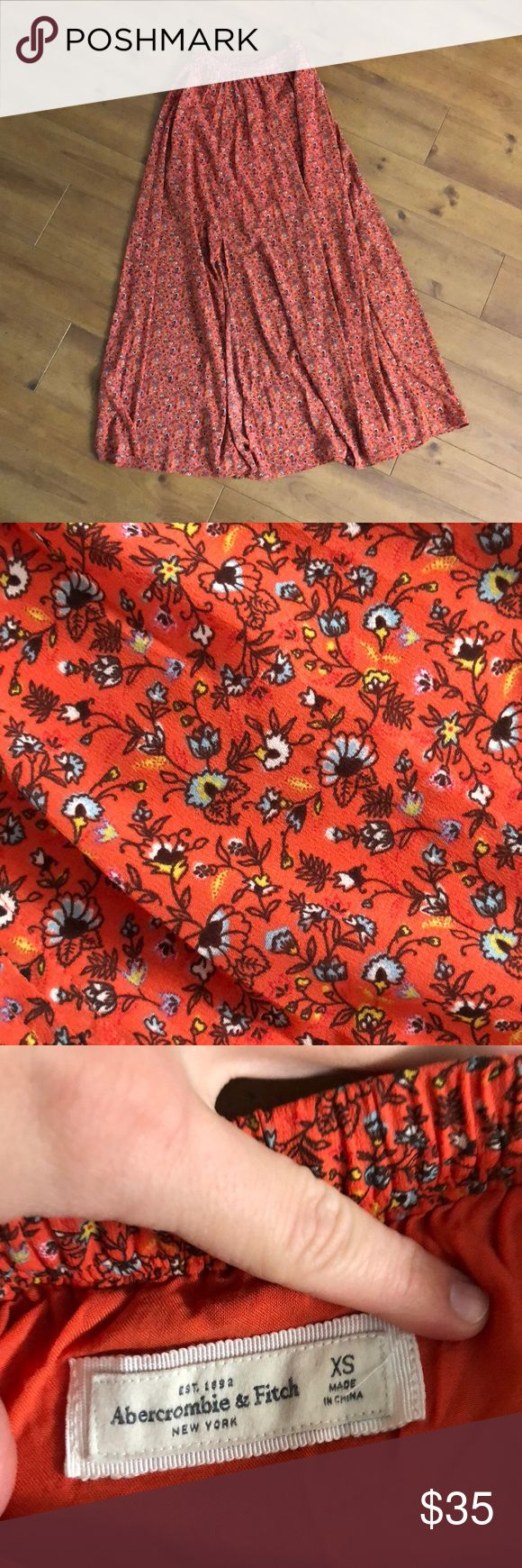 Floral maxi skirt A&F floral maxi skirt. I consider it a salmon color, others say it's red.  Soft and flowy and layered.  Not super heavy but not super lightweight either.  Hidden side slit and lined on top.  Elastic waist band and sits at smallest part of waist.  Only worn a couple times. (So cute with graphic tees!) So cute and I hate to get rid of it! Abercrombie & Fitch Skirts Maxi