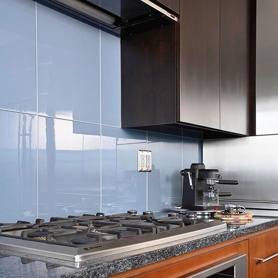 Large Glass Backsplash Tiles Reflect This Kitchen S Sleek And Refined Style Http