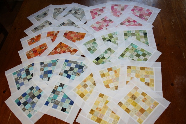 scrap busting rainbow postage stamp quilt.   Never seen one with sashing in-between the blocks, but it looks very interesting.  Maybe I'll try it.