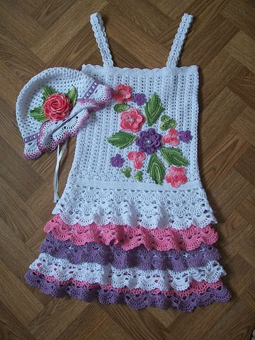 Pretty crochet doll dress with flowers. This site has free diagram patterns.