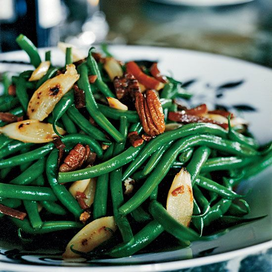 """Green Beans and Salsify with Country Ham and Pecans   For his simple side dish, Dean Fearing sautés crisp green beans with caramelized salsify, toasted pecans and strips of intense country ham. At home, he jokingly calls them """"all-day"""" green beans—in fact, they take about half an hour to prepare."""