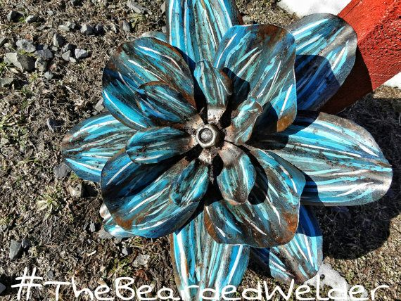 """Handmade, handpainted, welded metal flower wall decoration. Approximately 21""""x21""""x7"""". This piece will hang on a wall nicely or you may set on a table or a shelf. All of my sculptures are made by me from start to finish...from the vision to the finishing touches! Thank you for looking!  #TheBeardedWelder  www.facebook.com/thebeardedwelder  thebeardedwelder@gmail.com   Shop this product here: spree.to/agrw   Shop all of our products at http://spreesy.com/collectitorium      Pinterest selling…"""