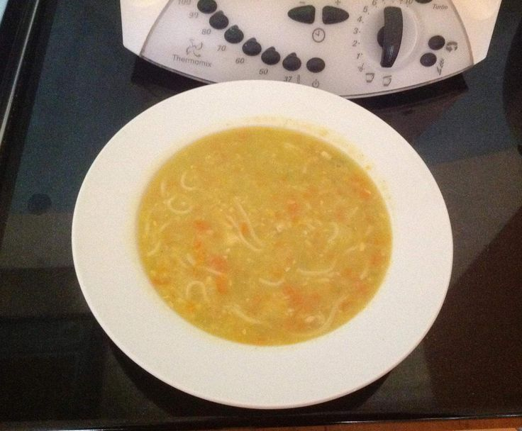 Chicken and sweet corn noodle Soup with carrot and celery