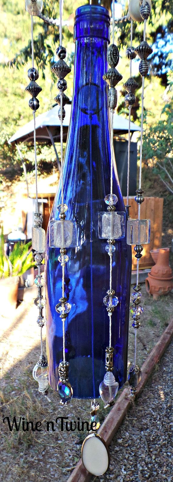 This is an original, one-of-a-kind wind chime. Made from a recycled wine bottle that is blue Tom has added a metal bracelet to the top and with a mixture of beads, baubles and charms hanging down it creates a lovey sound for any backyard or patio. Thank you for stopping by our shop! Tom and Diane