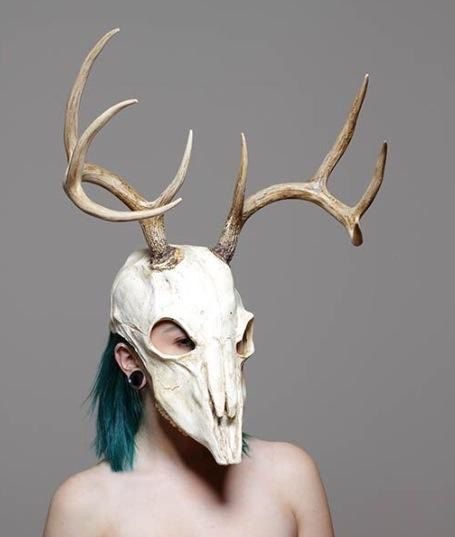 This is a soft urethane rubber mask with resin antlers. It fits up to a 23 inch head. It is reinforced with power mesh for extra durability.