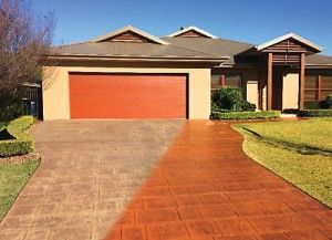 Driveway pressure cleaned and sealed with a colour enhancer and anti-slip.