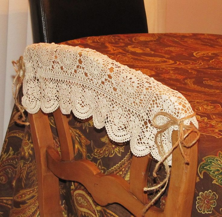 DYI - Pretty & Simple fall, romantic, or rustic chair covers.  Simply take a crocheted place mat, drape over the top of the chair, cut 4 strands of twine, 2 for each side, tie around chair sides!  Add some berries or leaves for color!
