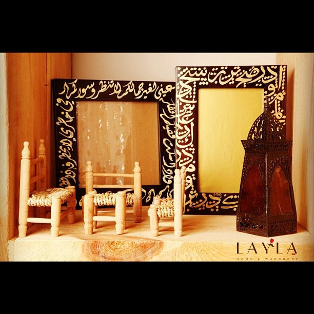 Miniatures of little chairs, available in live size at the gallery and made to order, with Calligraphed frames in the back drop!