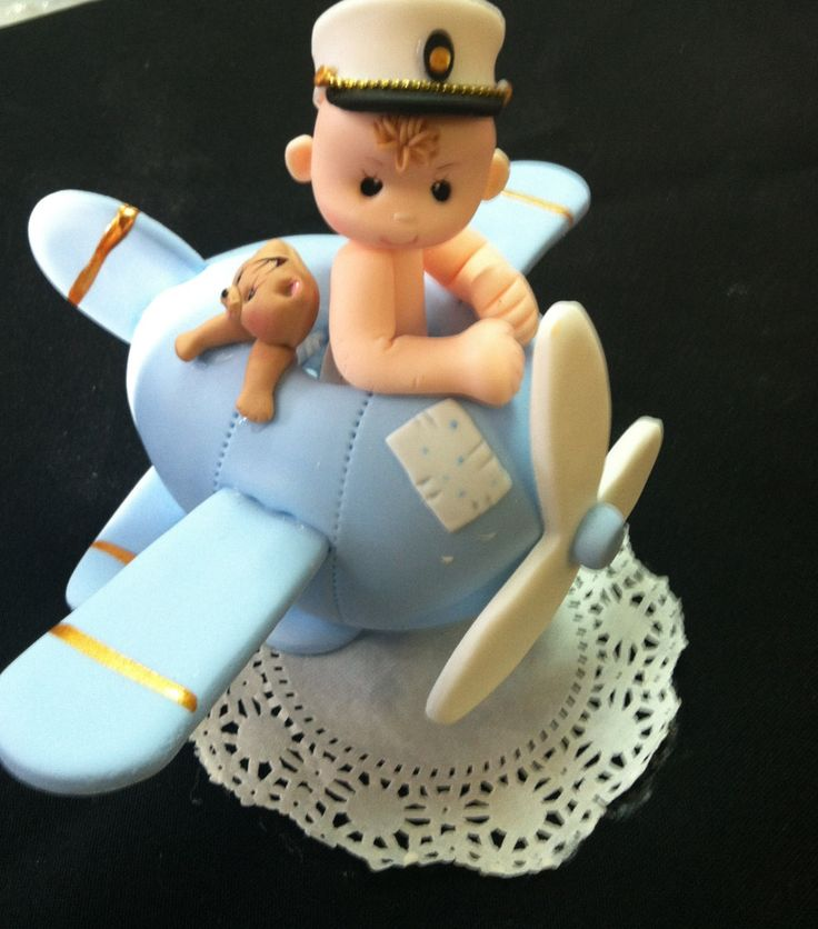 Beautiful and Elegant Handmade Airplane with Boy Cake topper Excellent for Plane Baby Shower and Pilot Birthday theme events ,made of Cold Porcelain These Airplane can be used as Birthday favors, Cake