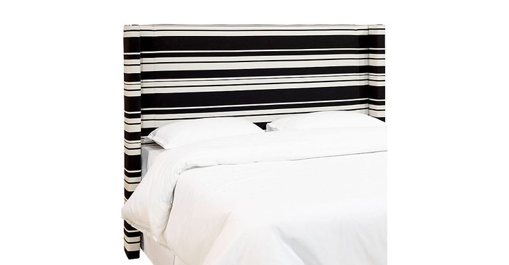 This headboard's striped cotton-blend upholstery adds a fun, lively punch of pattern and contrast to the bedroom. Attaches to any standard bed frame. Handcrafted in the USA.