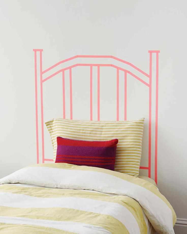 Using washi tape, make a whimsical focal statement in your bedroom with this faux headboard. It