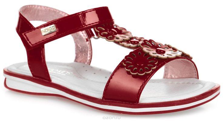 1-0710C/12Прелестные сандалии от Indigo Kids придутся по душе вашей девочке и идеально подойдут для повседневной носки в летнюю погоду! Верх модели, выполненный из искусственной лакированной кожи, оформлен декоративными цветочками с металлическими заклепками. Ремешок с застежкой-липучкой, оформленный металлическим элементом с названием бренда, обеспечивает надежную фиксацию модели на ноге. Внутренняя поверхность и стелька из натуральной кожи комфортны при ходьбе. Стелька оснащена…
