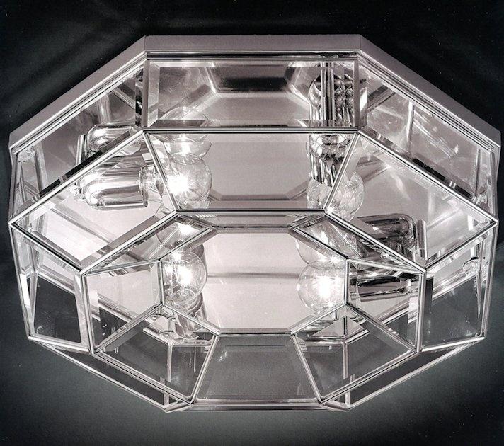 752-380.00.62 Soffitto dia. 56cm SP 16cm Cromo  Lampada da soffitto (plafone) ottagonale da condominio in ottone finitura cromo, con vetro cristallo molato. Di facile montaggio, pulizia e manutenzione e' adatta a condomini eleganti sia classici che moderni. Dimensioni della lampada diametro 56cm SP 16cm