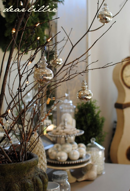 Christmas ornaments hanging from twigs--easy decoration
