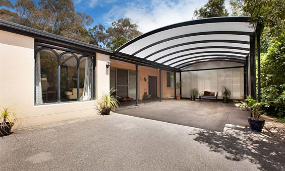 polycarbonate roofing, curved, lets light through, but offers privacy